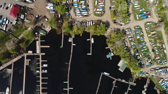 Aerial View of Boats on Land Near the Harbor