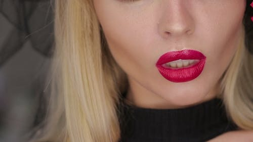 Crop Female Posing with Lips