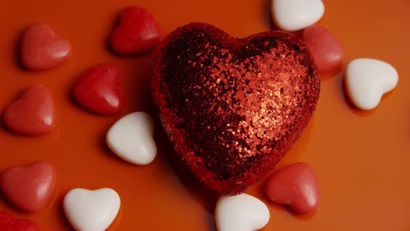 Rotating stock footage shot of Valentines decorations and candies - VALENTINES 0046