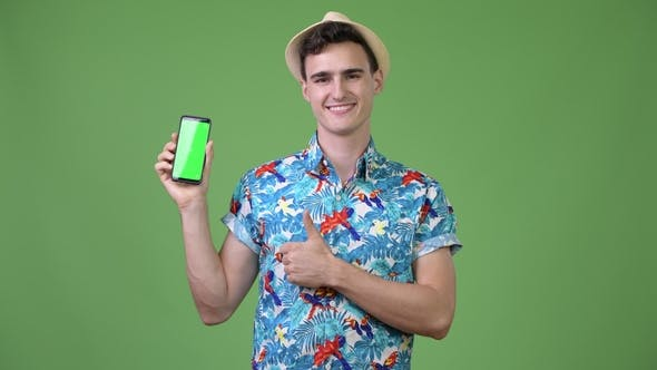 Thumbnail for Young Handsome Tourist Man Showing Phone and Giving Thumbs Up