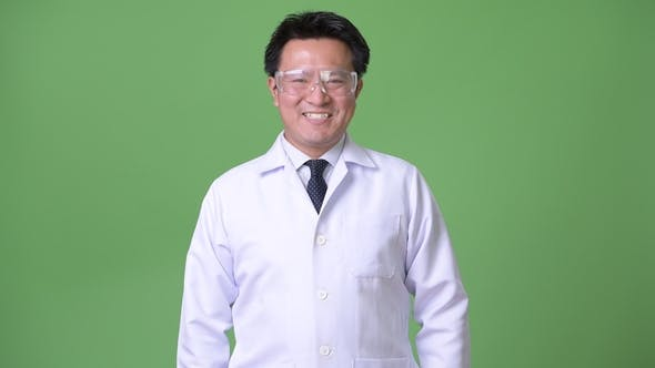Thumbnail for Mature Japanese Man Doctor Wearing Protective Glasses