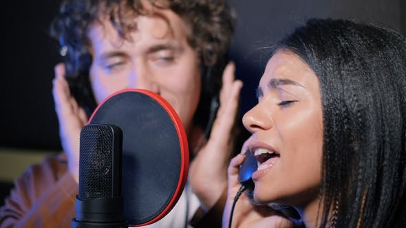Thumbnail for Two Young Singers Performing Their Song in Record Studio. Professional Musician Duet Recording New
