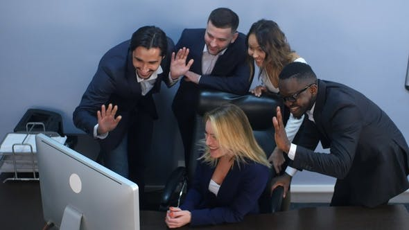 Thumbnail for Group of Multiracial Business People Looking at a Screen of Laptop, Having Video Conference
