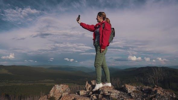 Thumbnail for Traveler Girl Is Recording Selfie Video Outdoors
