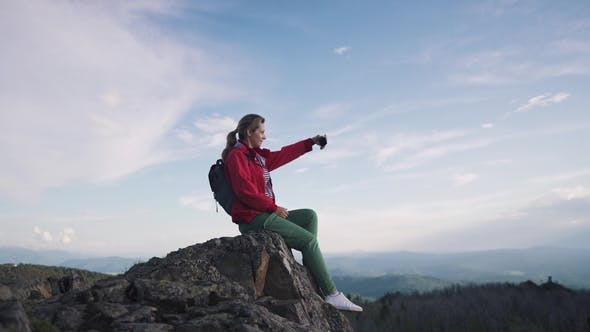 Thumbnail for Traveler Girl Takes a Selfie in the Mountains