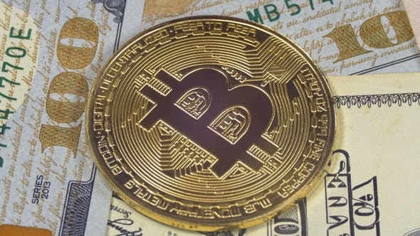 Thumbnail for Gold Bitcoin Coin Cryptocurrency, BTC Rotate on Background with US Dollars