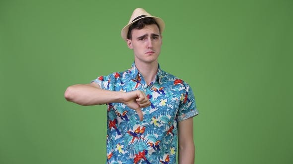 Thumbnail for Young Handsome Tourist Man Giving Thumbs Down