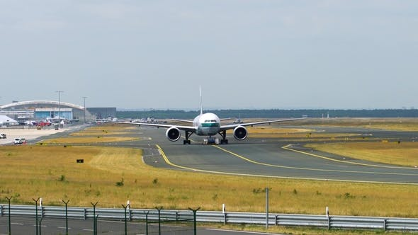 Thumbnail for Tow Tractor Towing a Passenger Plane on the Runway of the Airfield
