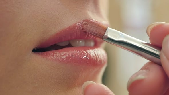 Thumbnail for Makeup Artist Paints Lips of a Beautiful Smiling Girl