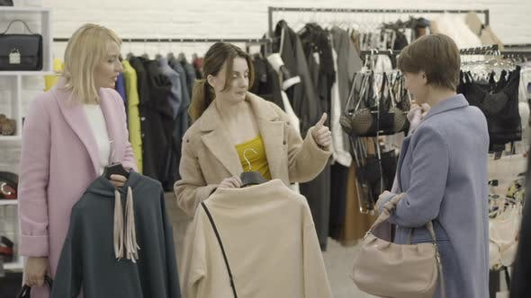 Thumbnail for Beautiful Wealthy Caucasian Women Discussing Clothes in Clothing Store and Leaving with Purchases