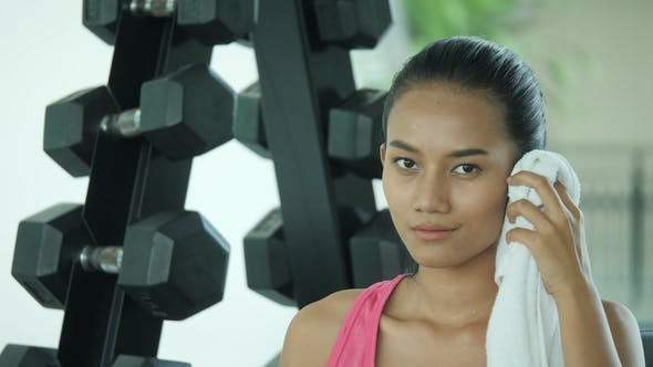 Thumbnail for Portrait of Young Asian Female Athlete Wiping Sweat in Gym