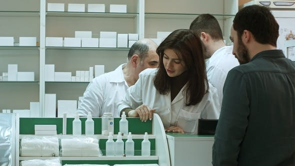 Thumbnail for Professional Pharmacist and Pharmacy Technician Working in Drugstore