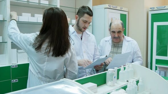 Thumbnail for Team of Pharmacist Checking Documents and Medicine at Drugstore