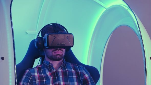 Thumbnail for Young Man Immersing in Virtual Reality Experience