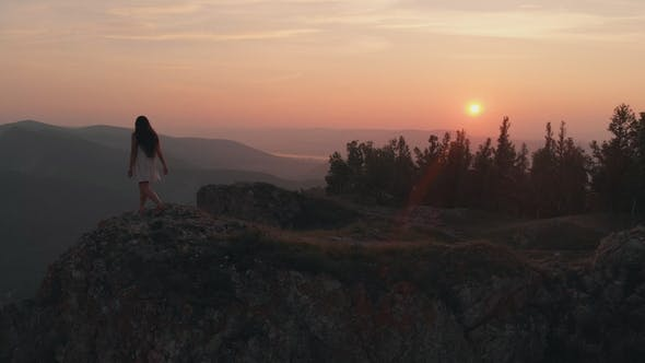 Thumbnail for Young Happy Woman Standing on the Edge of a Cliff
