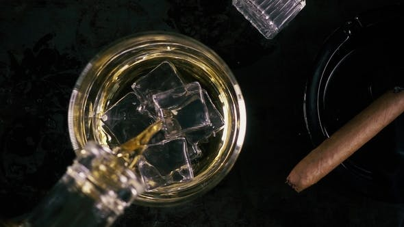 Thumbnail for Whiskey in a Glass and Cigar