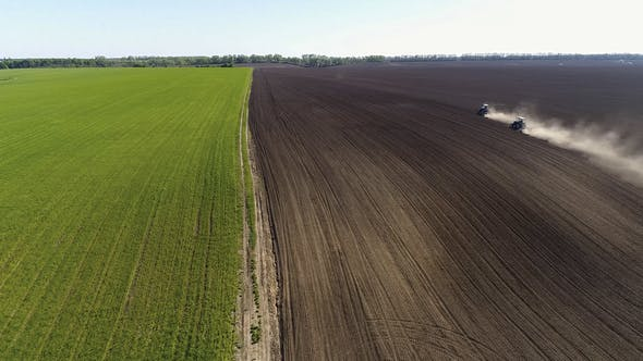 Thumbnail for Aerial View of Agricultural Tractors Cultivating Field.