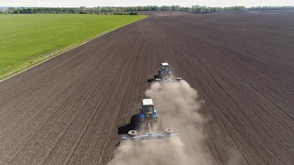 Thumbnail for Aerial View of Agricultural Tractors Cultivating Field