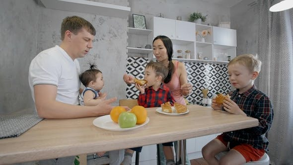 Thumbnail for Multi-ethnic Family with Three Children Eating Dessert in the Kitchen