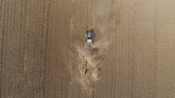Thumbnail for Aerial View of Agricultural Tractor Cultivating Field. Tractor At Work.