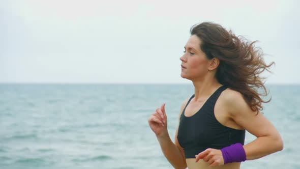 Thumbnail for Independent Young Woman Running on Way to Success. Morning Training Outdoors