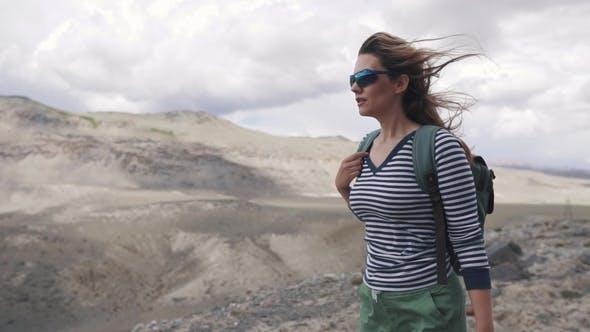 Thumbnail for Girl Tourist Goes on a Mountainous Terrain