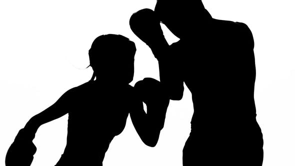 Thumbnail for Guy with a Girl Preparing for a Kickboxing Competition. Silhouette. White Background
