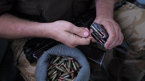 Thumbnail for Soldier Loading a Bunch of Bullets Into a Handgun Magazine