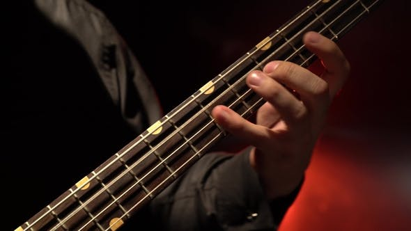 Thumbnail for Bass Guitar. Fingers Fingering the Strings.
