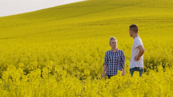 Thumbnail for Farmers Discussing At Rapeseed Field