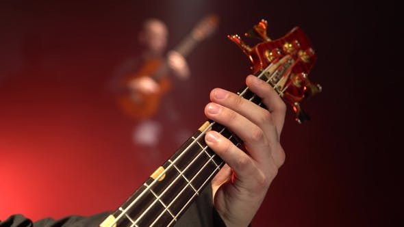 Thumbnail for Bass Guitar. Two Guitarists Play the Guitar