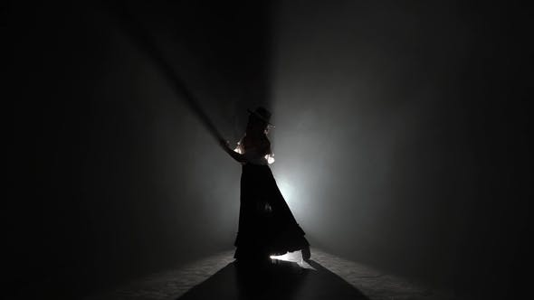 Thumbnail for Flamenco Girl Is Dancing in Castanets in Her Hands Dancing Light From Behind Smoke