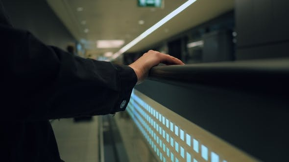 Thumbnail for Airport Passageway, Unidentified Female Hand. Moving Walkway at Busy Airport. Travelator and People