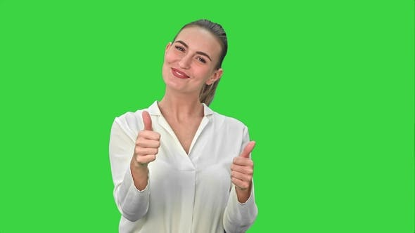 Thumbnail for Happy Excited Woman Showing Approval Hand Gesture Thumb Up and Smiling on a Green Screen