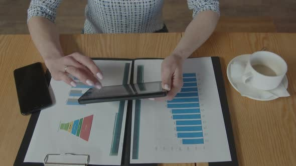 Thumbnail for Hands of Woman Working with Tablet and Charts