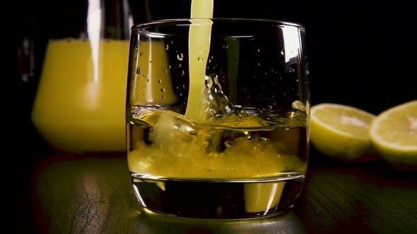 Thumbnail for in a Strong Alcoholic Drink in a Glass Pour the Juice