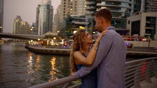 Woman Tenderly Hugs Her Husband, Couple Celebrates Anniversary