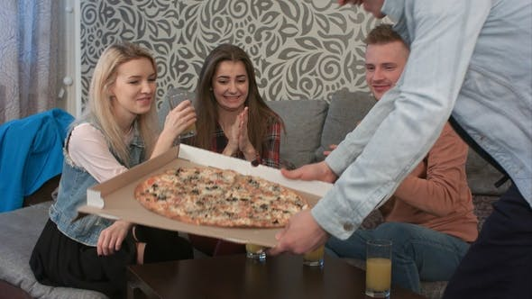 Thumbnail for Group of Friends Talking, When Their Friend Bringing Takeaway Pizza