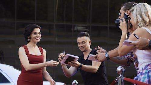 Celebrity Woman Taking Selfie with Fan