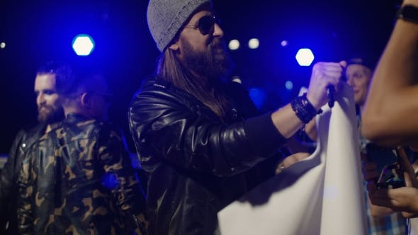Thumbnail for Musicians Giving Autographs To Fans