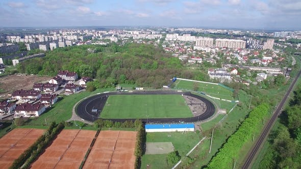 Thumbnail for Aerial Small Stadium in the City Without People From Above