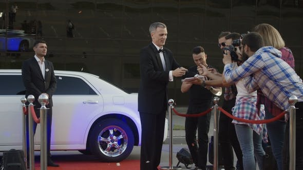 Thumbnail for Adult Celebrity Giving Autographs on Red Carpet