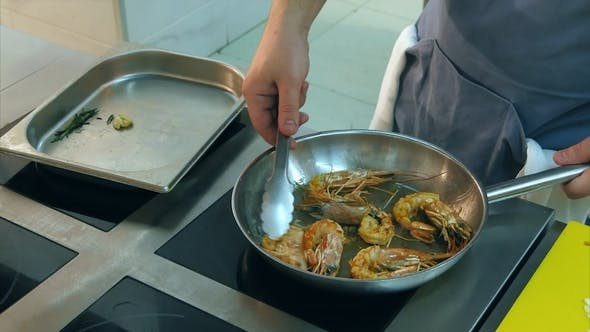 Thumbnail for Chef Frying Royal Shrimps on a Pan and Adding Sunflower Oil