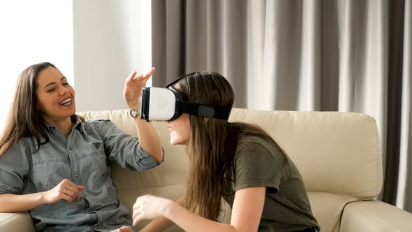 Thumbnail for Teenage Girl with a VR Headset on Next To Her Bigger Sister