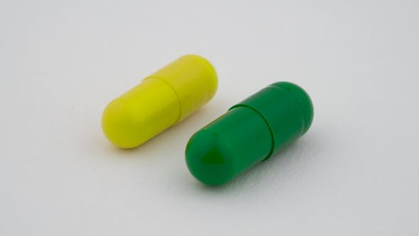 Cover Image for Two Hard Starch Capsules Rotating on the Turn Table