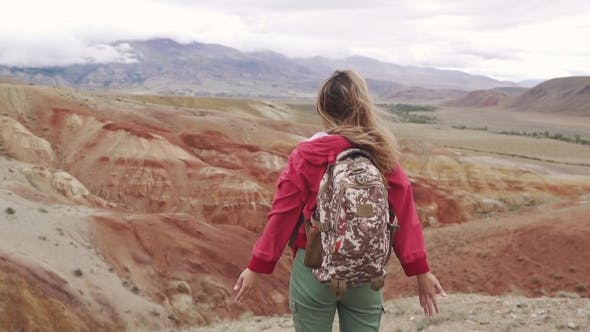 Thumbnail for Girl with Backpack Enjoying the View of the Mountain