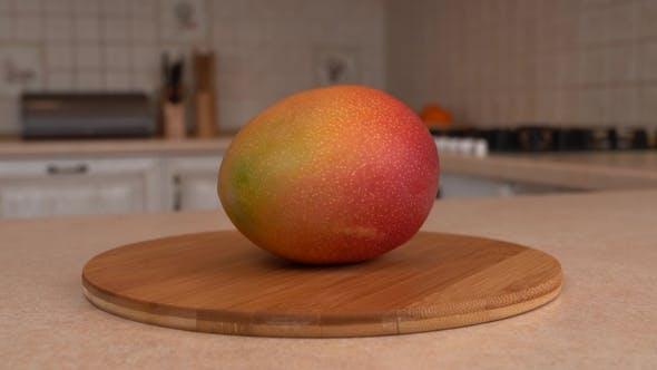 Thumbnail for Fresh Mango Fruit. Rotating Camera with White Kitchen on the Background