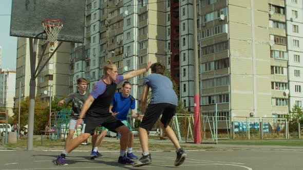 Teenage Streetball Players in Action Outdoors