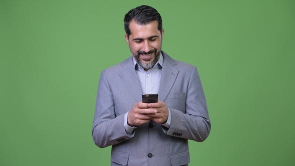Thumbnail for Handsome Persian Bearded Businessman Using Phone