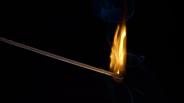 Burning Match on a Black Background in